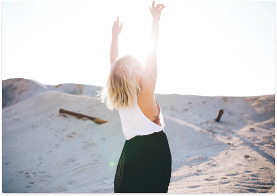 Woman with arms raised, happy to have a chronic pain support group.