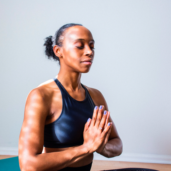 Woman in the middle of meditation for chronic pain.